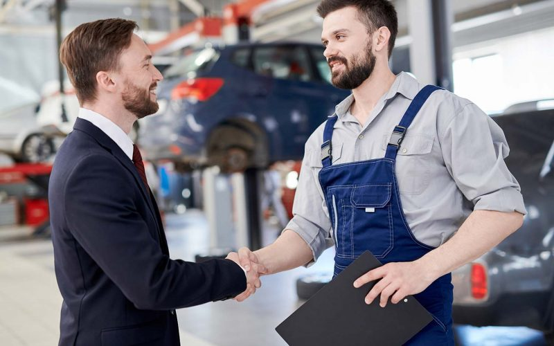 mechanic-shaking-hands-with-businessman-small.jpg